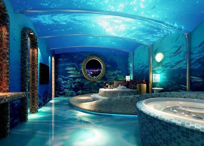 迪拜钻戒主题酒店 迪拜钻戒旅馆有天蓝色月亮神的感觉,这个设计可以说是疯狂透顶,每个分支都是一个房间! 迪拜的钻戒旅馆。它有天蓝色月亮神的感觉,这个设计可以说是疯狂透顶,每个分支都是一个房间,你如果去住的话,记得时时背着降落伞。 钻戒上的每一个钻石都是一个房间,只有当房间转动到与主体建筑的连接点的时候,客人们才可以入住。  洞穴主题旅馆设计 土耳其这座洞穴旅馆有7间大房,可以变成25个房间。每一个房间的大小和形状都不同。也有人喜欢住茅草搭建的木房,更有人喜欢住在具有原始风味的洞穴里,看看全球,矿藏地下